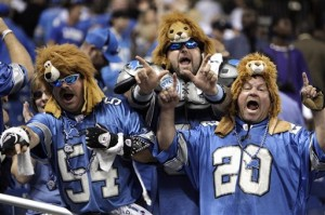 Faithful Lions fans celebrate following the 19-14 win over the Redskins.