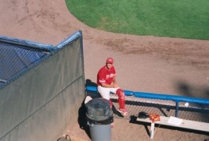 Bill Artz, alone in the pen, waiting to warm up a Phillies reliever.