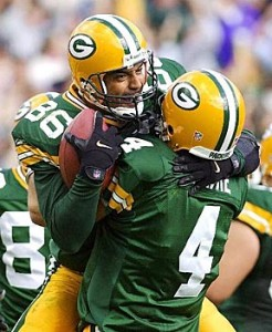 Favre and Antonio Freeman connected on two touchdown passes against the Vikings.