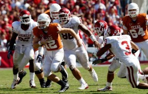 Colt McCoy and the Texas Longhorns held on to defeat the Oklahoma Sooners and remain undefeated.