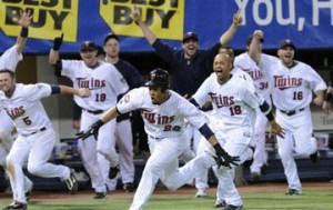 The Twins celebrate following their dramatic 12-inning win over the Tigers.