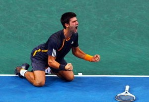 Novak Djokovic celebrates match point in the Final match against Gael Monfils.