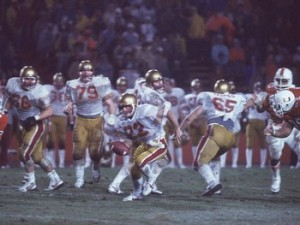 Doug Flutie scrambled out of pressure before launching the game-winning pass against the University of Miami.