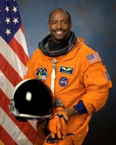 Former college football star Leland Melvin is currently in outer space aboard Space Shuttle Atlantis.