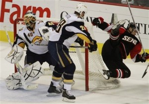 Paul Gaustad knocks down Jason Spezza in the first period against Ottawa on Saturday night.