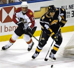 Steve Montador skates away from Gregory Campbell in the first period on Wednesday night.