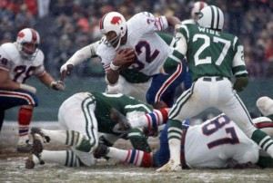 On December 16, 1973, O.J. Simpson rushed for 200 yards against the New York Jets to become the first player in NFL history to pass the 2,000-yard rushing mark for a single season.