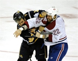 Patrick Kaleta and Paul Mara exchange punches late in the third period