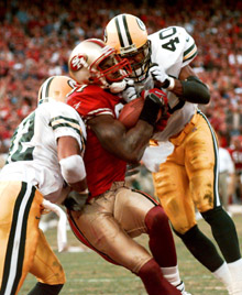 Despite being sandwiched between two defenders, Terrell Owens caught the game winning touchdown for the 49ers against Green Bay in the 1998 Playoffs.
