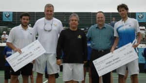 Tournament Director and officials awarding prize money to Haase and Grojean