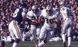 Clarence Davis (#28) rushed for a career-high 137 yards in Super Bowl XI.