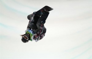 Shaun White performs many amazing tricks on the snowboard.