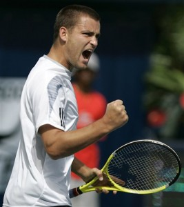 Mikhail Youzhny fought back to even the match after the rain delay in Dubai.