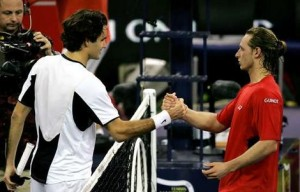 Nalbandian defeats Federer in 5 grueling sets.