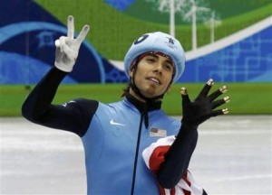 Ohno celebrates capturing his 7th Olympic medal in Vancouver.