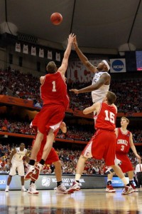 Jeff Foote of Cornell goes for the block as Kentucky's DeMarcus Cousins shoots.