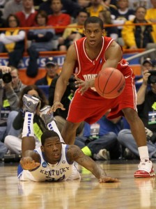Louis Dale moves around DeAndre Liggins to gather a loose ball for Cornell