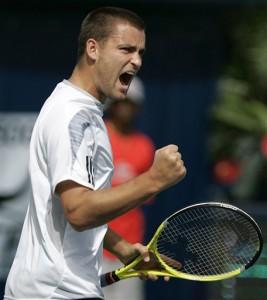 Mikhail Youzhny battles during final in Dubai against Djokovic.