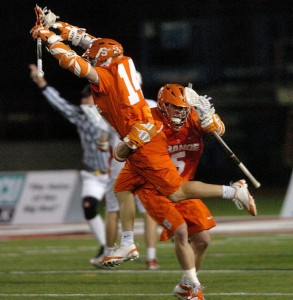 Chris Daniello leaps in joy after his game-winning goal against Cornell.