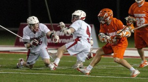 Syracuse senior Chris Daniello manuevers around two Cornell defenders to score the game-winning goal just before the final buzzer.