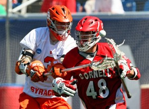 Matt Abbott attempts to knock the ball away from Cornell's Roy Lang in the 2009 title game.