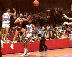 Lonnie McFarlan passes to John Smith for layup that would shock top seeded DePaul.