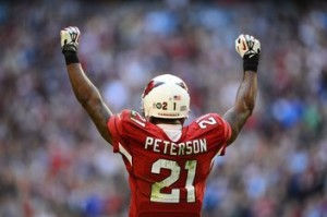 Flying high: Patrick Peterson celebrates as the Cardinals got their first win since Week 4 with  a 38-10 defeat of the Lions.