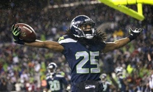 Richard Sherman celebrates after intercepting a ball in Sunday night's win.