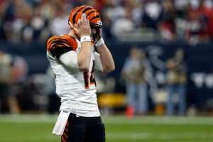 Bengals quarterback Andy Dalton struggled hearing the play calls in noisy Reliant Stadium and struggled even more in executing them as Cincinnati's season is done.