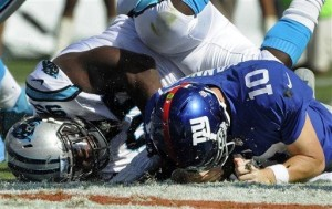 Eli Manning was sacked seven times as the Giants fell to 0-3.
