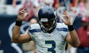 Russell Wilson celebrates  a second-half touchdown, getting the Seahawks back in it.