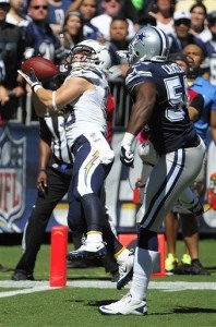 Danny Woodhead hauls in one of his two touchdown receptions in San Diego's 30-21 win over the Cowboys.