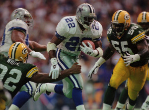 "Part of the famed ""Triplets"", Emmitt Smith breaks free of Packers' defenders in the 1995 NFC title game"