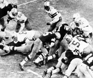 "Bart Starr scores the winning touchdown in ""The Ice Bowl"" in 1967"