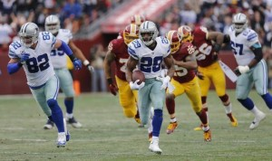 Facing the arch rival Redskins in Washington, Murray breaks free. He set a Cowboys single season rushing record during the victory by running for 100 yards on 20 carries.