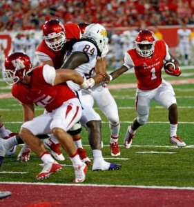 Greg Ward Jr. has led Houston to a perfect record both by passing and running.
