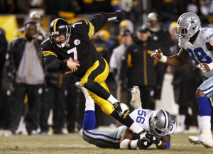 Ben Roethlisberger scrambles away from a Dallas defender.