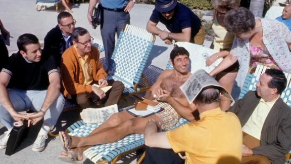 There was Brent Musburger on the far left sitting with Joe Namath poolside prior to Super Bowl III.