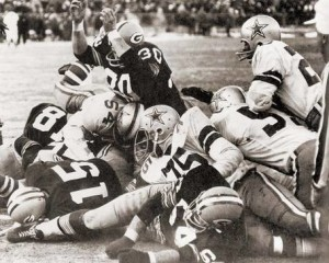 Bart Starr (15) scored the game-winning touchdown in the final seconds.