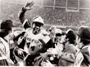 Hank Aaron being celebrated after hitting career home run number 715 on April 8, 1974