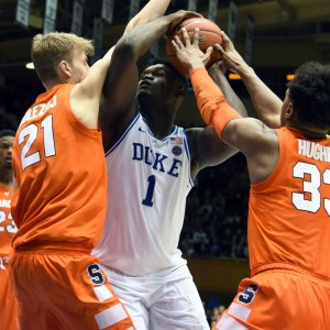Duke freshman phenom Zion Williamson battles with Syracuse defenders inside.